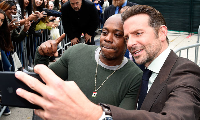 Dave Chapelle and Bradley Cooper made sure to get a selfie, too.