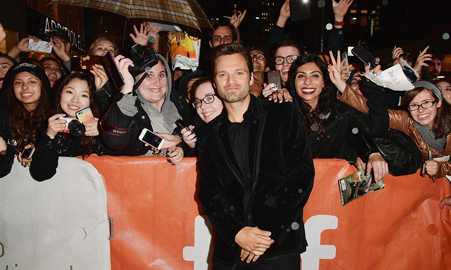 Clad in a velvet jacket, Sebastian Stan posed with throngs of fans at the premiere of <em>Destroyer</em>.