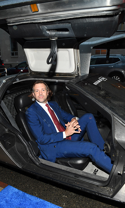 Ready to cruise! <em>Driven</em> star Jason Sudeikis posed in a DeLorean outside the film's fete at RBC House on Sept. 10.