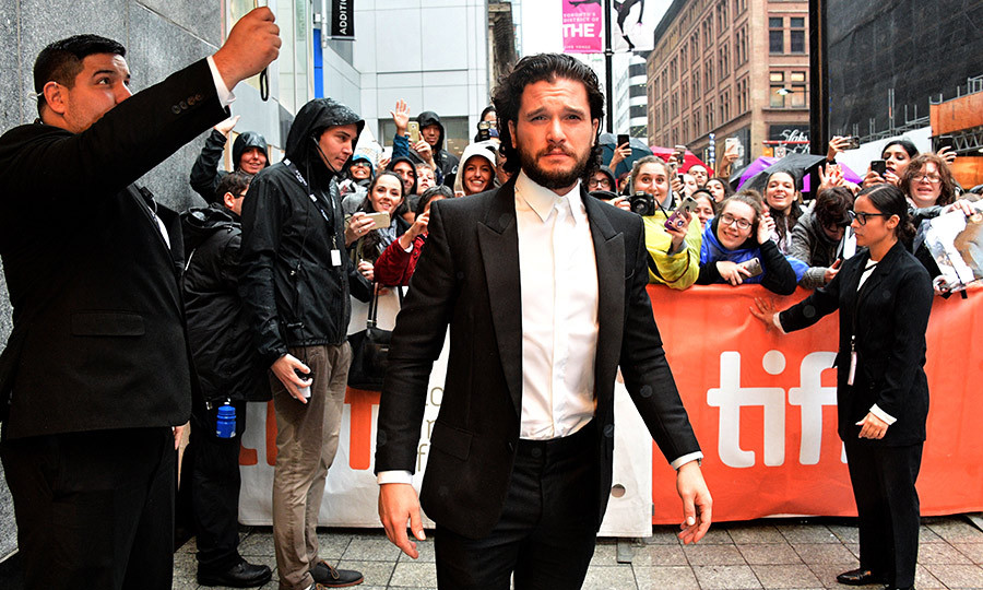 Kit Harrington braved the rain outside the Winter Garden theatre, where <em>The Death and Life of John F. Donovan</em> was making its debut. Still, he looked dapper as ever in a black tuxedo jacket and buttoned-up white shirt. 