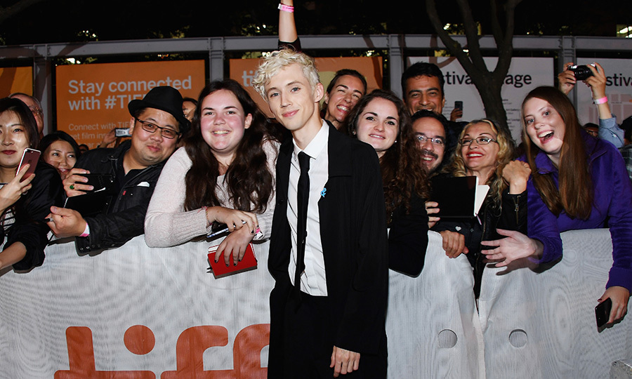 Troye Sivan looked happy as ever to be greeting his fans outside of the Princess of Wales theatre.