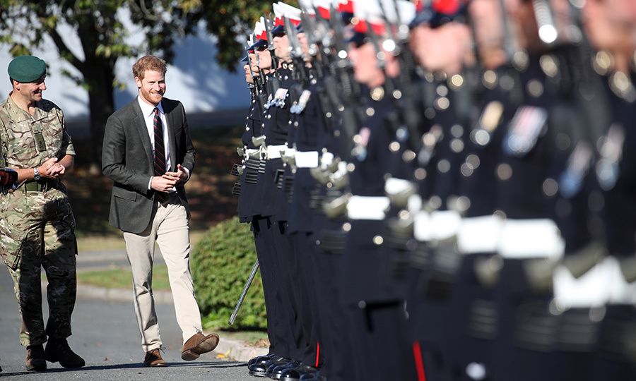 The Duke of Sussex greeted a line of military men, showing off his megawatt smile.