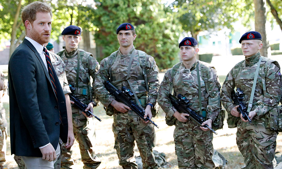 Prince Harry looked completely at ease while chatting with some commandos in between training sessions.