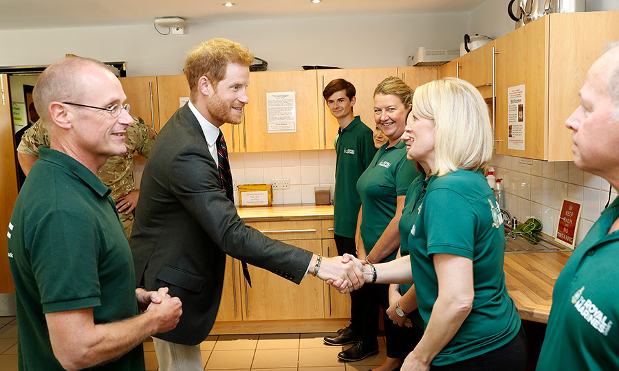 Harry shook hands with officials, clearly showing off his charm.