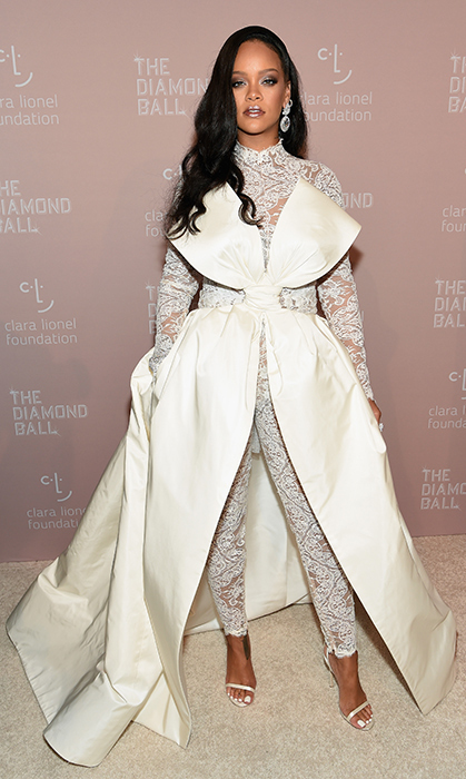 Fashion savvy fans look forward to Rihanna's famous Diamond Ball every year – a lavish event full of style and music that benefits the singer's charitable organization, The Clara Lionel Foundation. Of course, Rihanna's outfit did not disappoint. The award-winning star turned up in a glamorious white lace jumpsuit with a bow train by Alexis Mabille Couture. Keeping her hair sleek and makeup smoky, RiRi glittered in Chopard jewelry.