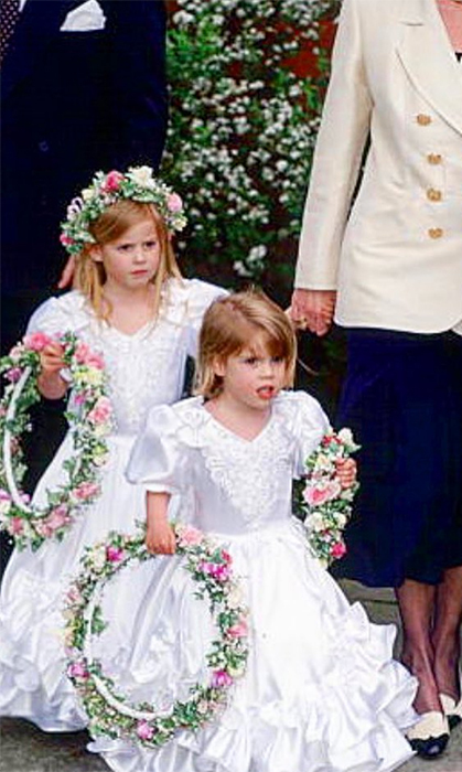 "The princess shared an absolutely adorable throwback of herself and Princess Beatrice, acting as bridesmaids at their former nanny's wedding. It was obviously in celebration of the beginning of Eugenie's own planning for her Oct. 2018 nuptials, as she captioned the snap: ""90s throwback...wedding planning starts!!""