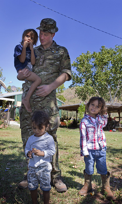 The prince played with local children during a visit to the Wuggubun community in Western Australia.