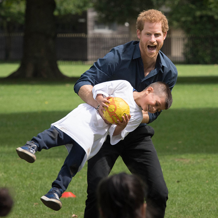 Prince Harry playfully swung a kid in the air while visiting StreetGames' Fit and Fed program.