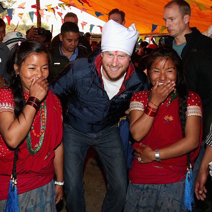 Back in 2016, Harry shared a laugh with two local girls while visiting Nepal.