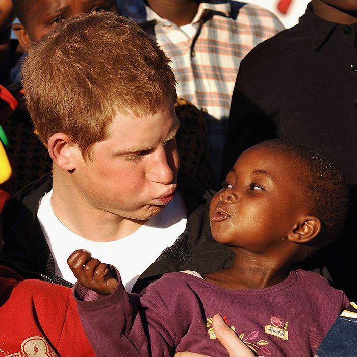Harry is the king of silly faces! The prince puckered his lips at an adorable little girl while visiting Lesotho with his charity, Sentebale, in 2006.