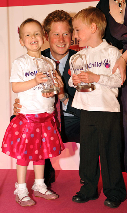 Prince Harry showed off his lovely smile at the 2008 WellChild Awards, but it was no contest against these two cuties!