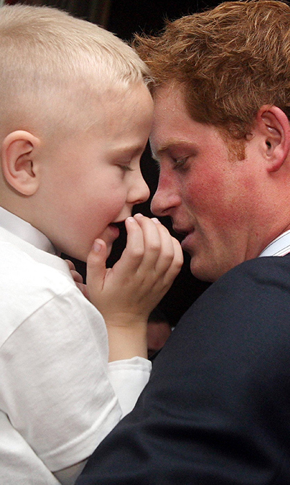 The following year, Harry shared this sweet moment with Alex Burke, another winner of a WellChild Award.