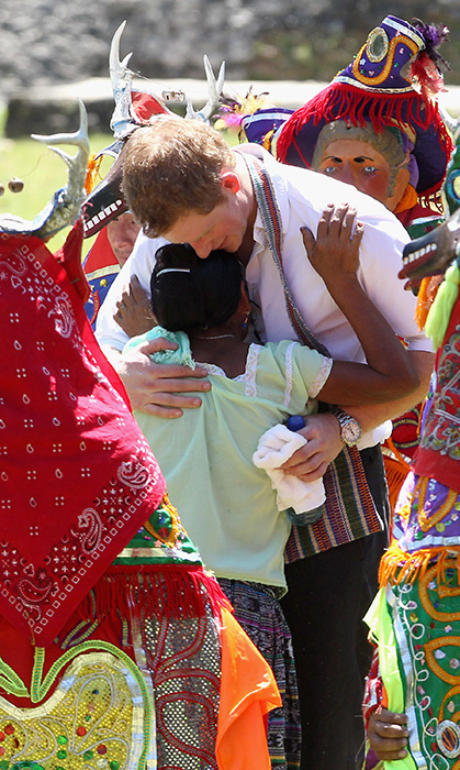 Harry hugged a young woman while visiting Belize in 2012 for the Diamond Jubilee tour.