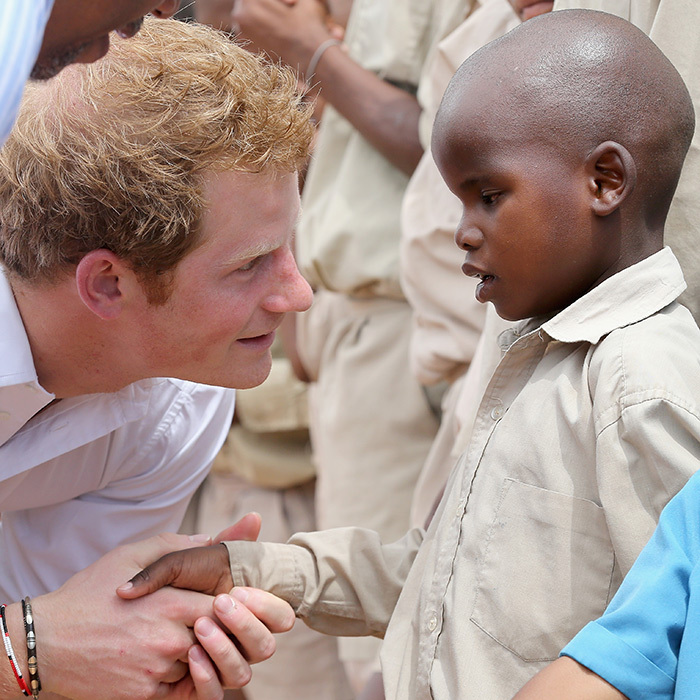 Another trip with Sentebale in 2013 saw Prince Harry shake hands with a sweet child at St. Bernadette's Centre for the Blind in Lesotho.