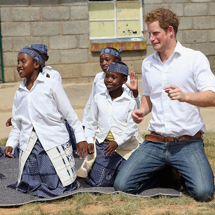 We're not sure Prince Harry is much of a dancer, but he gave it his all while meeting with kids in Maseru, Lesotho in 2013.