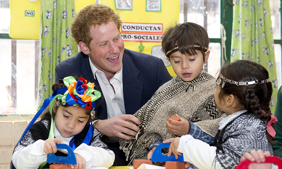 While traveling through Santiago, Chile, Prince Harry enjoyed some craft time with three adorable children.