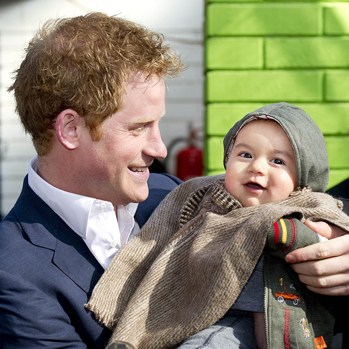 Too much cuteness for one photo! Prince Harry held Matias Gonzalez while in Chile.