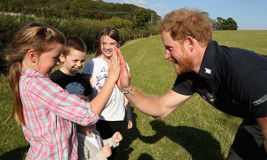 The royal high-fived a little girl during a Walking with the Wounded event in 2015. He was on his way to Ludlow with the group as a patron of the expedition.