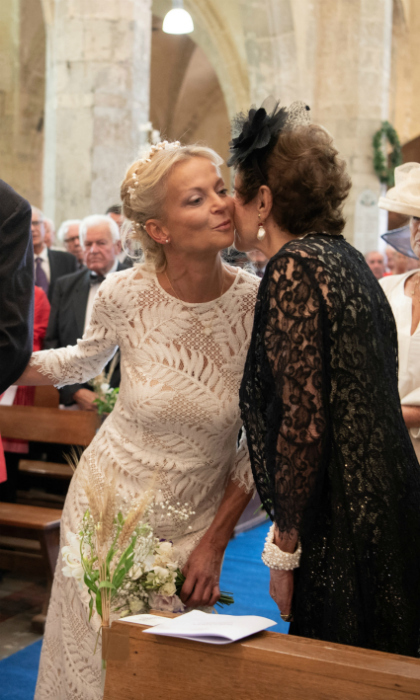 As she made her way down the aisle, Princess Helene stopped to give her mother Princess Maria Pia a sweet kiss. Clad in a glitzy black gown with pearl accessories and a matching fascinator, the glamorous 83-year-old certainly lives up to her Italian roots!