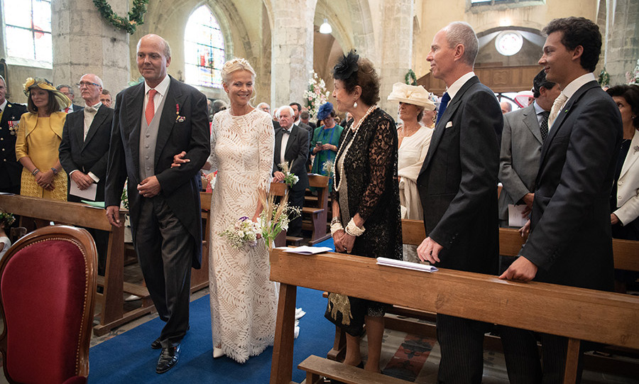 The bride's mother Princess Maria Pia of Bourbon Parme, brother Prince Michael of Yugoslavia and son Leopold Gaubert lined the first pew. The bride couldn't help but smile widely as she passed them during the intimate ceremony at Saint Etienne de Janville church in Janville, France.