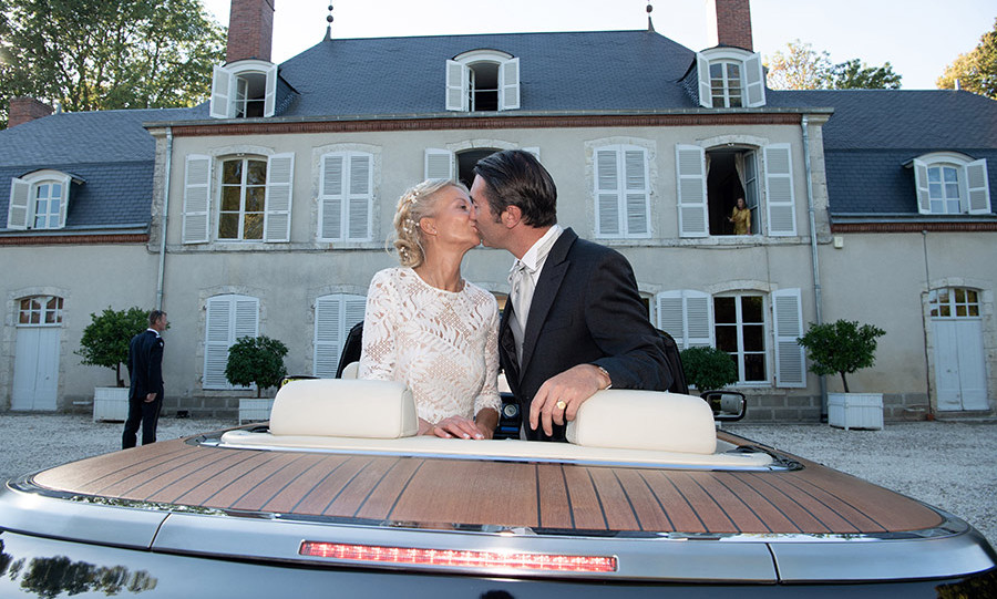 Sealed with a kiss! The newlyweds posed in a Rolls-Royce convertible after their wedding on Stanislas's property, the Chateau de Villeprévost in Tillay-le-Péneux, where they currently reside. The loved-up pair welcomed their friends and family into their home for the boisterous reception. 