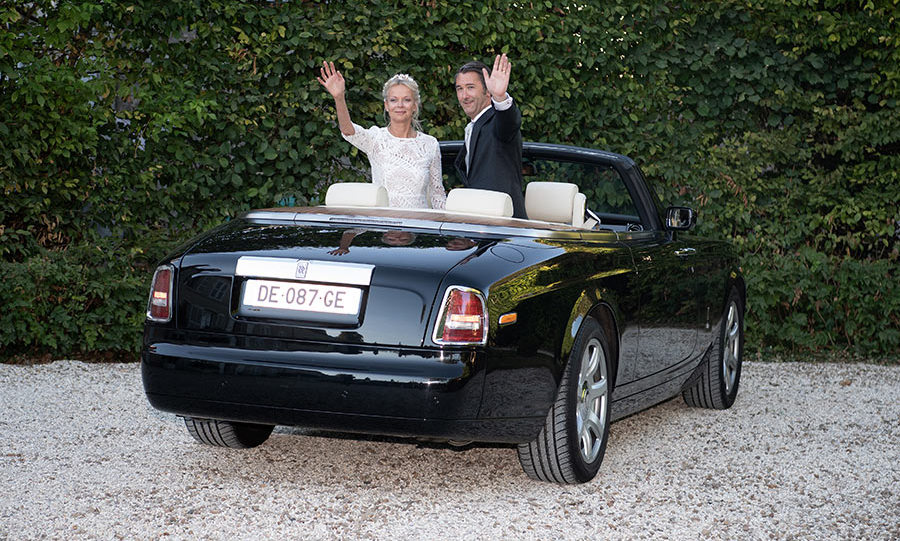 Introducing the newlyweds! The pair waved to the camera while posing for photos after their wedding in a convertible Rolls-Royce.