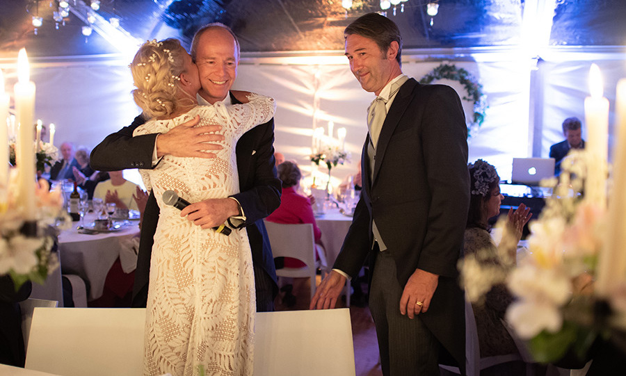 The bride gave her brother, Prince Michael of Yugoslavia, a huge hug after he made a speech for the newlyweds at their candlelit reception. 