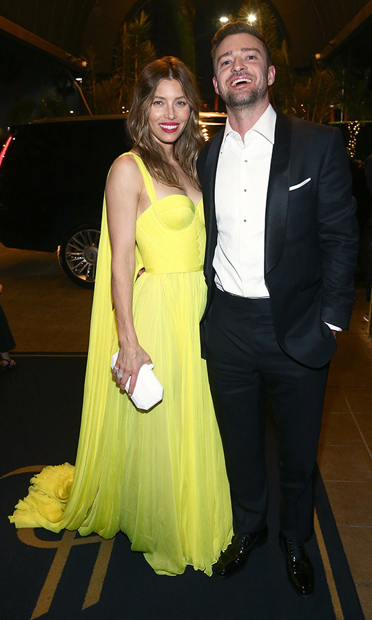 Jessica Biel traded white for neon yellow as she hit the Google party hosted by Emmy hosts Colin Jost and Michael Che alongside hubby Justin Timberlake.