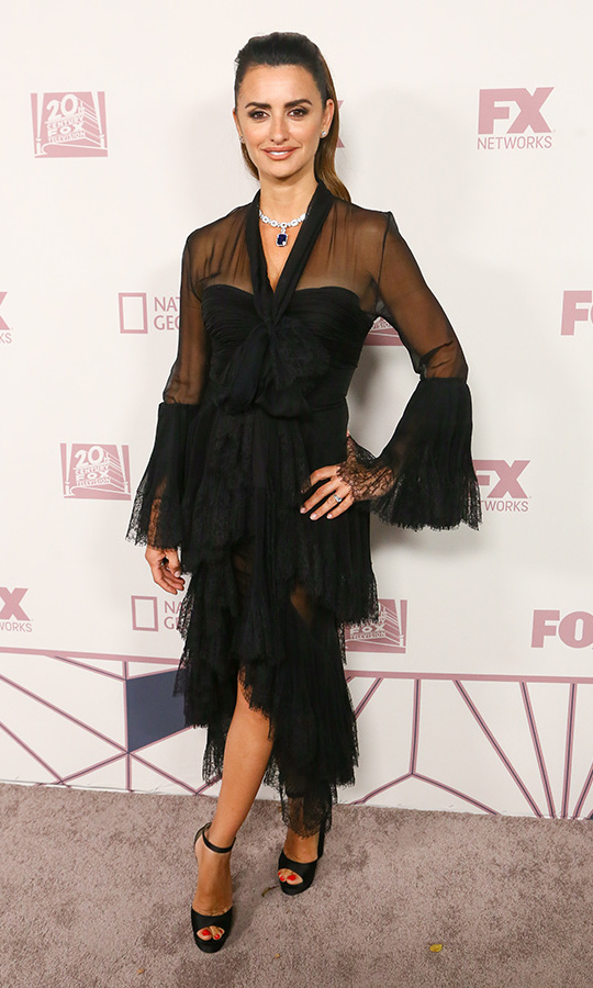 Penelope Cruz was a feathery sensation earlier in the evening, but she went from angel to femme fatale in this ruffled, semi-sheer confection for the FX party. 