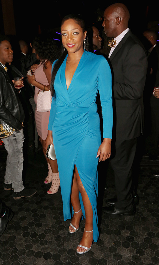 Tiffany Haddish slipped out of her multicoloured red-carpet gown and into this bold blue wrap-style dress to dance the night away at the Samsung Galaxy soiree!