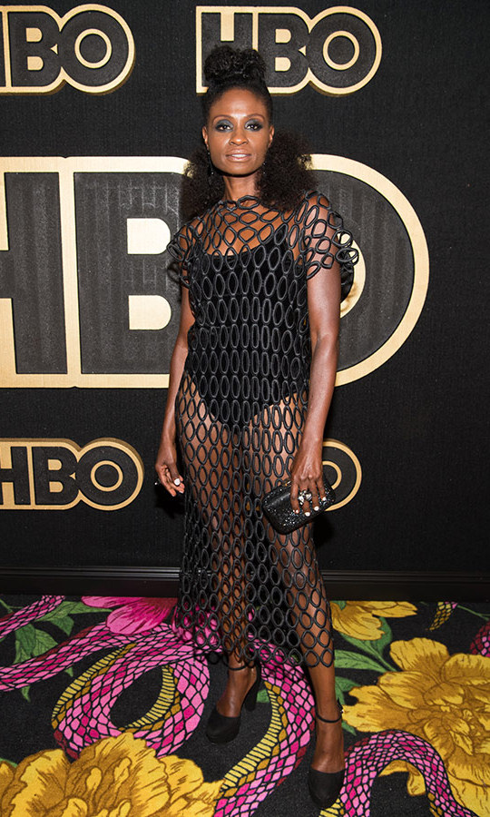 Adina Porter hit the HBO bash in a cool netted dress, a stunning swap from the silky yellow number she donned on the red carpet.