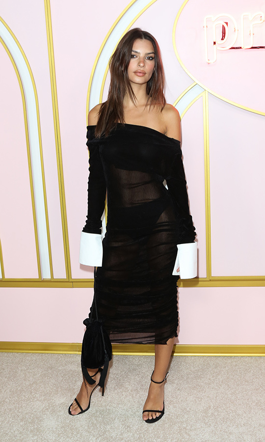 Emily Ratajkowski hit the party circuit, including the Amazon Prime fete, in a sheer black off-the-shoulder number with long shirt cuffs. 