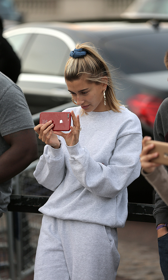 Hailey couldn't stop smiling and snapping photos of Justin as he played!