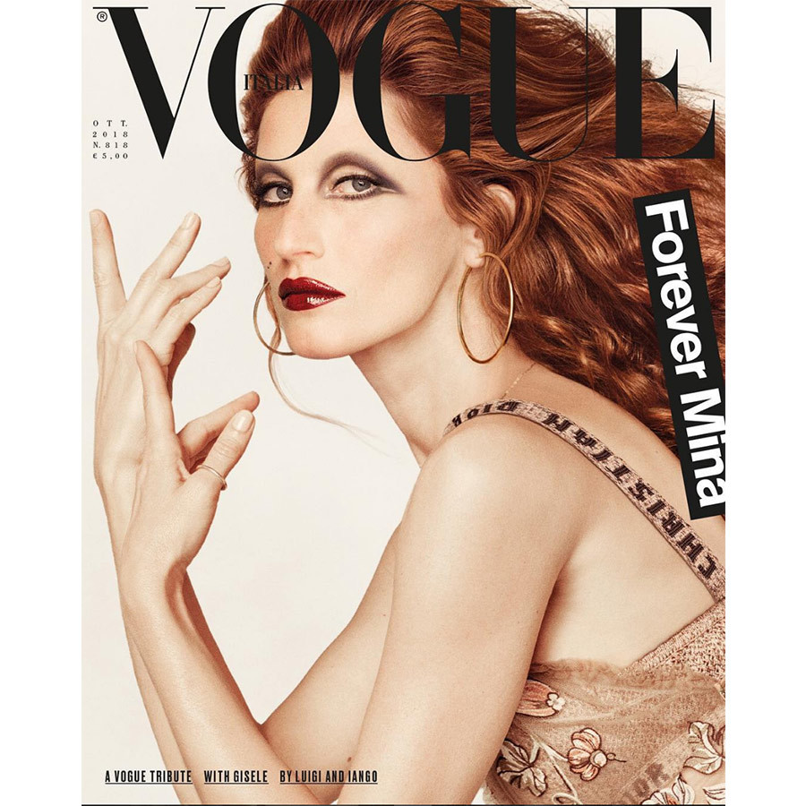 Gisele Bundchen stepped into the shoes of iconic Italian singer Mina Mazzini for a spread in <em>Vogue Italia</em>, complete with the chanteuse's red locks and birth marks.