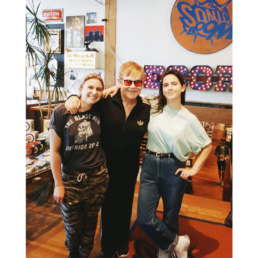 "<a href=""/tags/0/elton-john/"">Elton John</a> stopped by Sonic Boom record store in Toronto to pick up some vinyl on Sept. 18, snapping a pic with employees clad in an Adidas track suit and black glasses with orange lenses. Joking that Elton might be ""the only knight we'll ever have in Sonic Boom history,"" said manager Christopher Dufton, who shared that he instantly recognized the iconic singer. Elton is performing in Toronto as part of his Farewell Yellow Brick Road tour on Sept. 25 and 26.