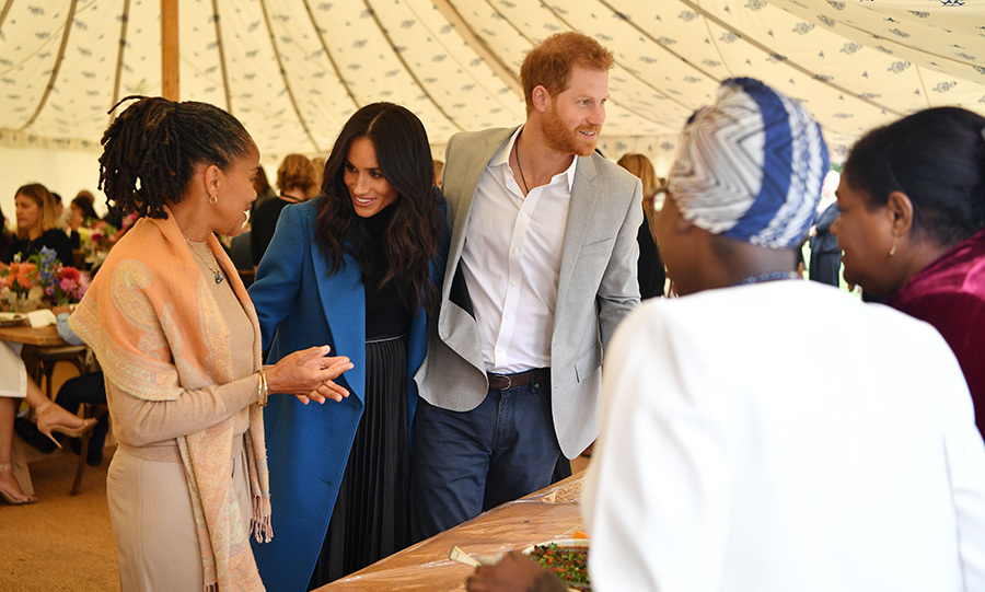 Meghan introduced her mother and husband to some of the women she's been working with on the cookbook.