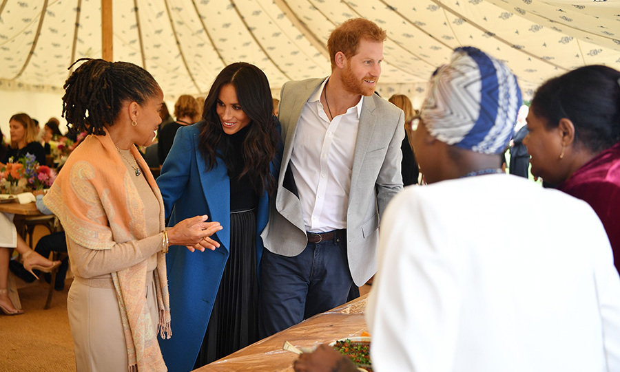 "<a href=""/tags/0/meghan-markle"">Meghan Markle</a> couldn't help but smile from ear to ear as she launched her first solo charity project on Thursday (Sept. 20) with her mom, <a href=""/tags/0/doria-ragland/"">Doria Ragland</a>, and husband, <a href=""/tags/0/prince-harry/"">Prince Harry</a>, by her side. <em>Together: Our Community Cookbook</em>, which features a foreword by the royal, is the culmination of months of work with the women of the Hubb Community Kitchen, all of whom were affected by the Grenfell Tower fire. The beautiful luncheon celebrating the book's launch took place in a pretty tent on the grounds of Kensington Palace. <strong>Click through to see all the best photos and read about the most touching moments from the event</strong>...