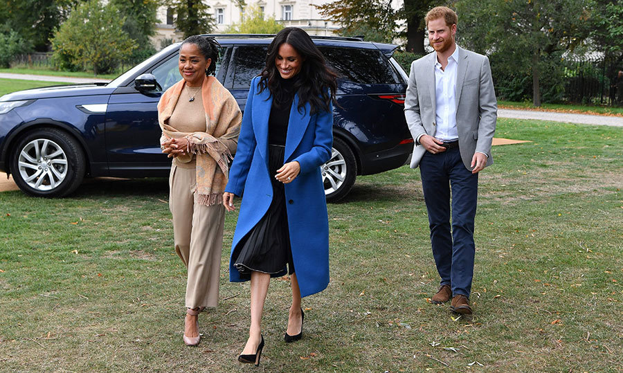 "The Duke and Duchess of Sussex arrived to the luncheon with a surprise guest, Meghan's mom Doria Ragland! The royal has credited her mother for inspiring her foodie lifestyle, so today's luncheon was the perfect opportunity for the 62-year-old to make her royal engagement debut. The duchess even called out her mother's cooking in the foreword she penned for the charity cookbook, writing, ""One of my own favourite meals is collard greens, black-eyed peas cornbread - a meal I would look forward to throughout my childhood.""