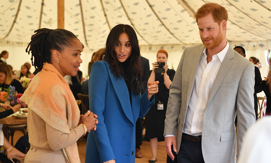 "Meghan had a ball introducing her husband Harry and mom Doria to the women she's been working with since she moved to London at the beginning of the year. ""I'm Meg's mum,"" Doria said, adding that she's ""head over heels"" proud of her daughter's accomplishment.