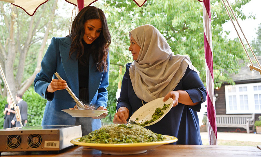 "A heaping plate of green rice caught Doria's attention, according to Emily. The social worker exclaimed, ""Oh I love that!"" adding that it was ""the first thing I asked about."" Meghan joked that ""everyone's just hungry"" as she added fresh mint and olive oil to a dish.