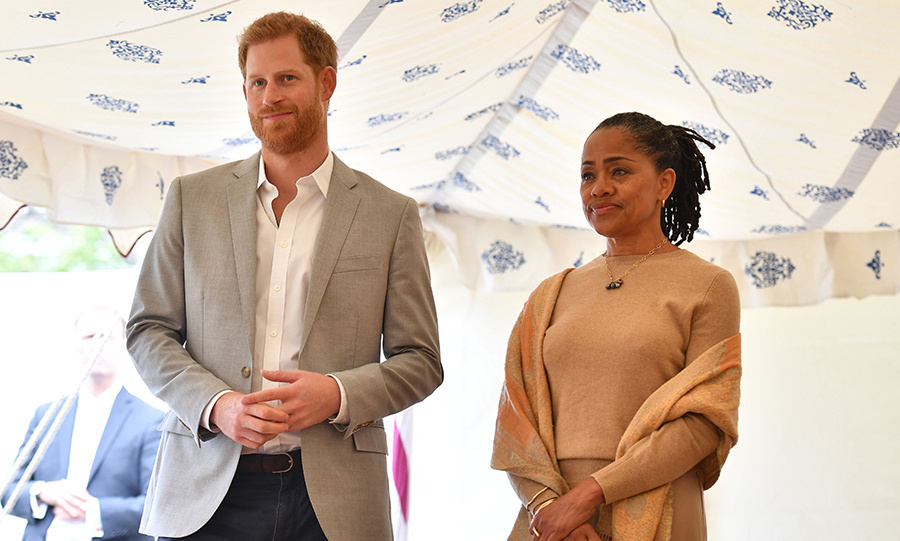 Prince Harry and his mother-in-law were brimming with pride, eyes a little misty, as they watched Meghan speek from her heart to officially launch the cookbook under the beautiful tent. Proceeds from the book benefit the Hubb Community Kitchen, so the women cooking at the event can keep sharing love through their food.