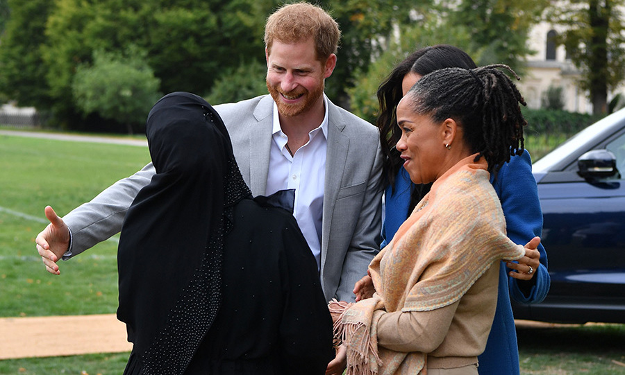 There were no shortage of hugs at the celebration, and you know Prince Harry was keen to get in on that action! Just like his wife, the royal loves a good hug. 