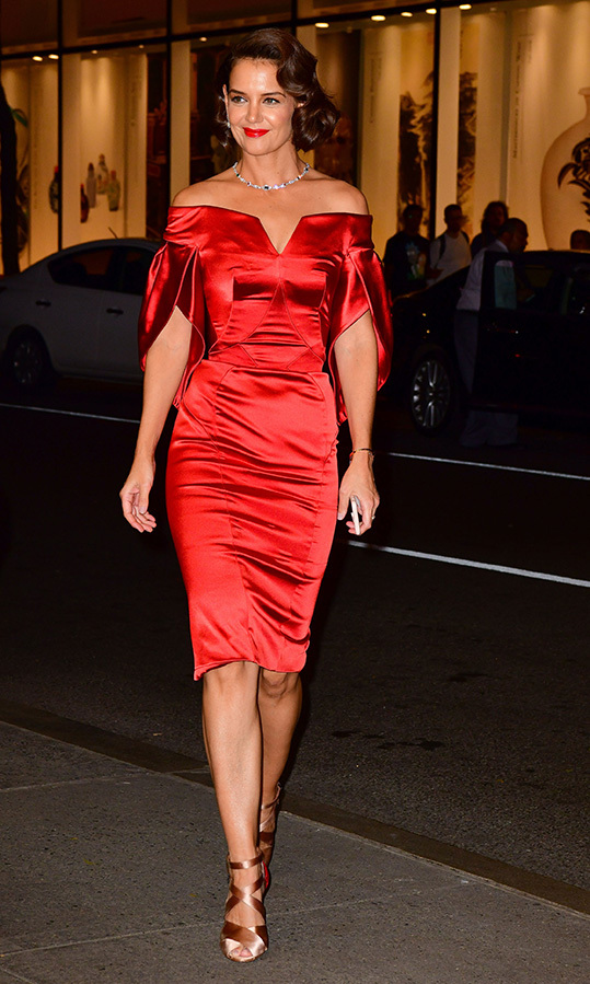 Va-va-voom! Katie Holmes was pure old Hollywood glamour on Thursday night (Sept. 20) as she attended an event toasting the New York Collection by Harry Winston at the Rainbow Room in New York. The actress dazzled in a body-hugging red sating dress with tulip sleeves, retro waves and a red lip - not to mention a dazzling Harry Winston piece around her neck.