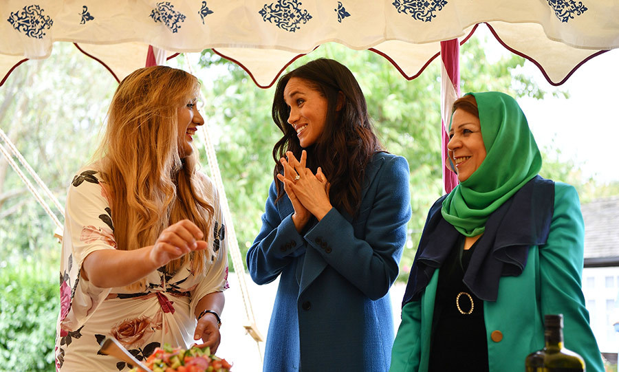 "Four months after saying ""I do"" to Prince Harry, Meghan revealed her first solo charity project: A cookbook called <em>Together: Our Community Cookbook</em> that she worked on with women from the Hubb Community Kitchen, all of whom had been affected by the tragic Grenfell Towere fire. Penning the foreword for the publication, the duchess also hosted a beautiful tented luncheon to celebrate the book's launch on the grounds of Kensington Palace, where she wowed attendees by making a three-minute speech with no notes. The event hosted a mix of the multicultural women she worked with and their families, people from the Royal Foundation, Al-Manaar Muslim Cultural Heritage Centre and the publishing house. 