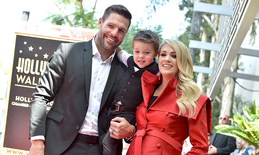 "<p>Carrie Underwood's adorable three-year-old son made a surprise appearance at mom's Walk of Fame ceremony with his dad, Mike Fisher, in Sept. 2018. Dressed to impress in a white short-sleeve shirt, black vest, jeans and a polka-dot bowtie, Isaiah stole the show as mom was honoured by Simon Cowell and Brad Paisley. ""He believes in me and we had another little man that believes in me too,"" Carrie said of her husband and son. ""Isaiah Michael, I love you so much. You're the best thing we ever did, the best thing. I love you and I'm proud of you and I believe in you too."" Carrie's baby bump was on full display in her belted red coat, as the family will welcome a new member in a few months.</p>