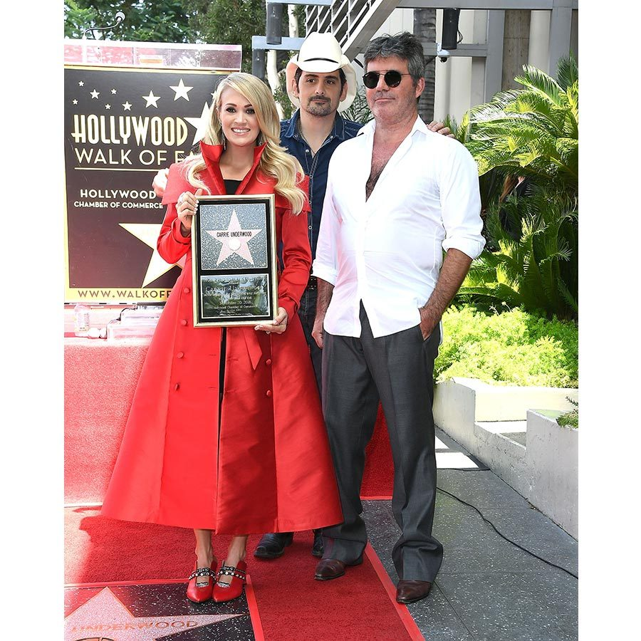 Carrie Underwood got her star on the Walk of Fame on Sept. 20, with her husband Mike Fisher and adorable son Isaiah by her side. The country superstar, who is pregnant with her second child, also had Simon Cowell and Brad Paisley on hand to celebrate the milestone. 