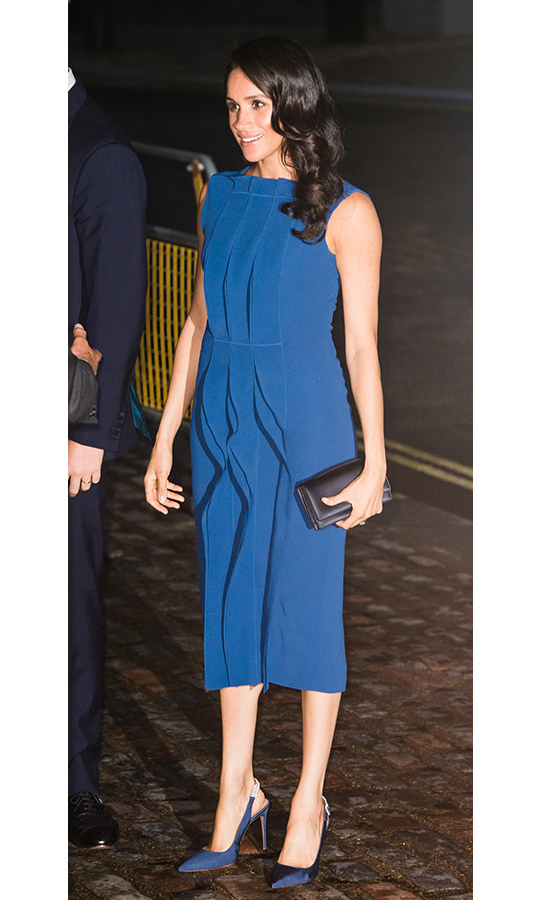 Bringing some old Hollywood glamour to the 100 Days to Peace gala on Sept. 6, the Duchess of Sussex topped off her royal-blue Jason Wu dress with a retro wave and natural makeup. She accessorized the pretty ruffled number with a new pair of shoes by her go-to Aquazzura - navy sling backs with bling on the strap - and a Dior clutch. Her beloved Birks Snowflake earrings were the icing on this look!