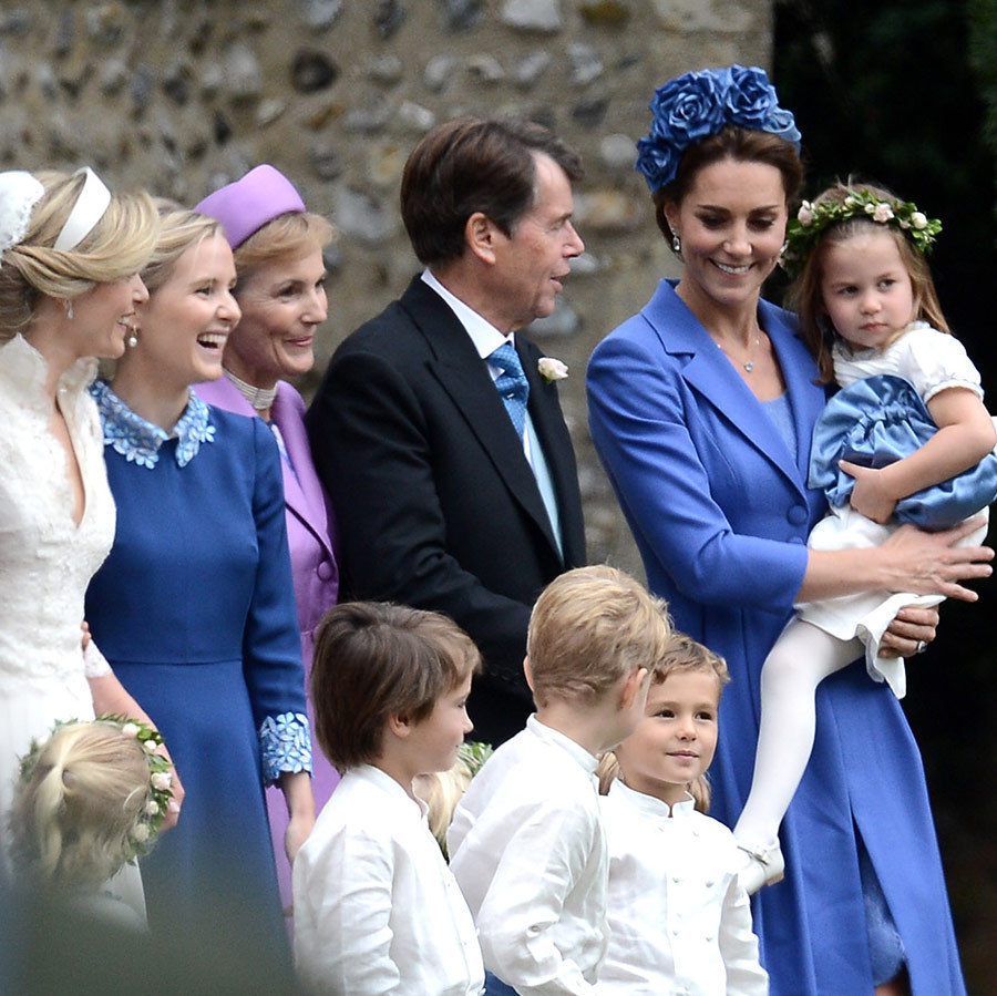 Prince George and Princess Charlotte made their third march down the aisle in the last few years on Saturday (Sept. 22) for Kate's dear friend Sophie Carter, who tied the knot with Robert Snuggs at St Andrew's Episcopal Church in Norfolk, where the Cambridges have their country home. Prince William and Kate's eldest son was pageboy while their daughter took another turn as bridemaid, clad in a pretty floral crown like her mom. The Middleton family was also on hand for the festivities, including Carole, Michael and James, though pregnant Pippa sat this one out. While Prince George stole the show with his hilarious marching antics and funny faces, Charlotte seemed sweetly calm in the arms of her mom and the bride. <strong>Click through to see all the best photos from the Cambridge family's big day out...</strong>