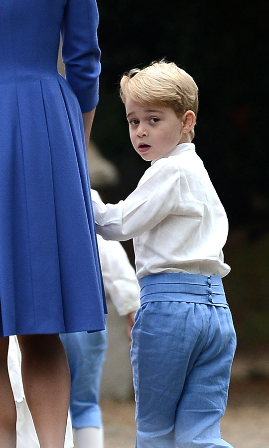 Prince George looked back at the camera as he held onto mom Kate's hand.