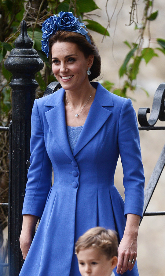 The Duchess of Cambridge opted for a gorgeous cornflower blue coat dress by Catherine Walker, which she paired with a stunning oversized floral headband. The rose-adorned topper by Juliette Botterill Millinery, which retails for $730, called the mind the floral headpiece she wore to Prince Louis' christening earlier this year.